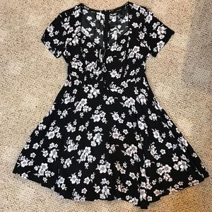 Flowery sundress with lace up detail